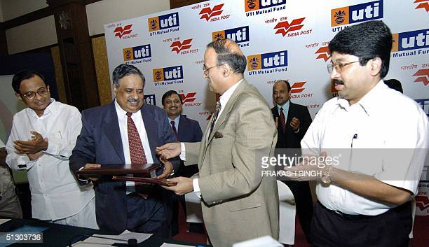 Chairman and managing director of Unit Trust of India asset management Company Pvt Ltd M Damodaran and Secretary of the Department of Post Vijay...
