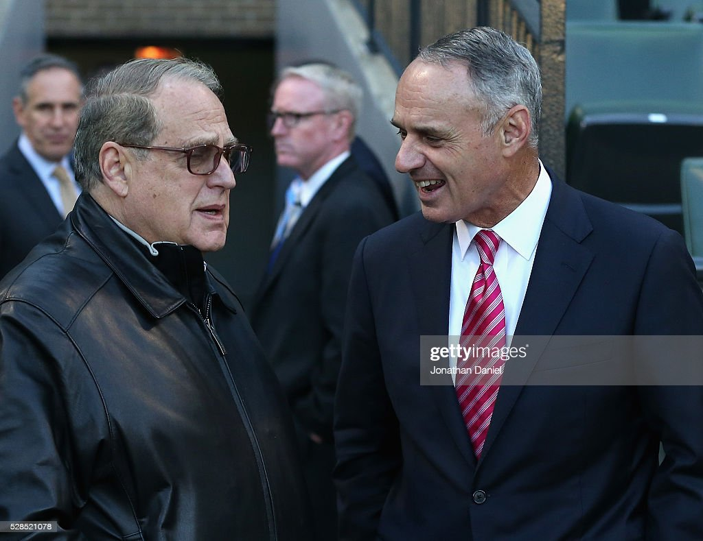 Chairman and owner <a gi-track='captionPersonalityLinkClicked' href=/galleries/search?phrase=Jerry+Reinsdorf&family=editorial&specificpeople=690117 ng-click='$event.stopPropagation()'>Jerry Reinsdorf</a> of the Chicago White Sox (L) talks with <a gi-track='captionPersonalityLinkClicked' href=/galleries/search?phrase=Rob+Manfred&family=editorial&specificpeople=2707217 ng-click='$event.stopPropagation()'>Rob Manfred</a>, commissioner of the baseball, before a game between the White Sox and the Boston Red Sox at U.S. Cellular Field on May 5, 2016 in Chicago, Illinois.