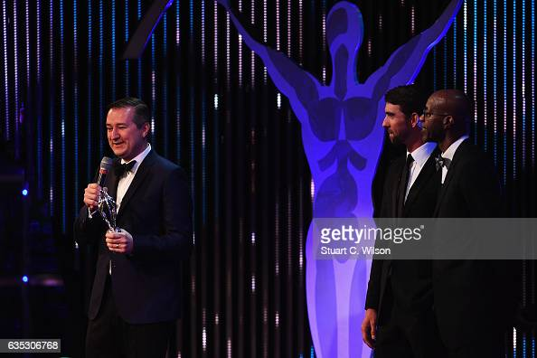 Chairman and owner of the Chicago Cubs Tom Ricketts accepts the Laureus World Team of the Year Award on behalf of the team as swimmer Michael Phelps...