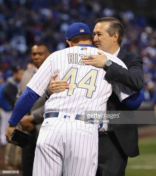 Chairman and owner Tom Ricketts of the Chicago Cubs hugs Anthony Rizzo during a World Series Championship ring ceremony before a game against the Los...