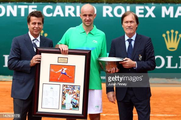 Chairman and President Brad Drewett and Zeljiko Franulovic Tournament Director present gifts to Ivan Ljubicic of Croatia after retiring from the...