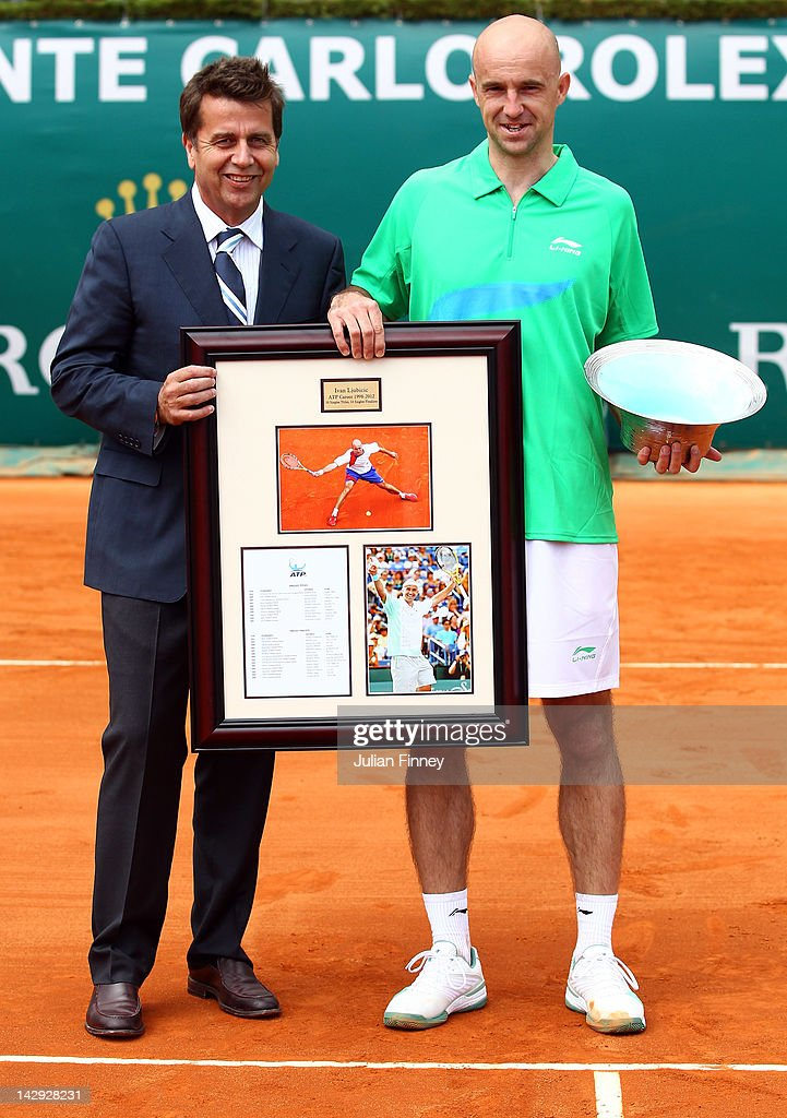 Chairman and President Brad Drewett presents gifts to Ivan Ljubicic of Croatia after retiring from the sport during day one of the ATP Monte Carlo...