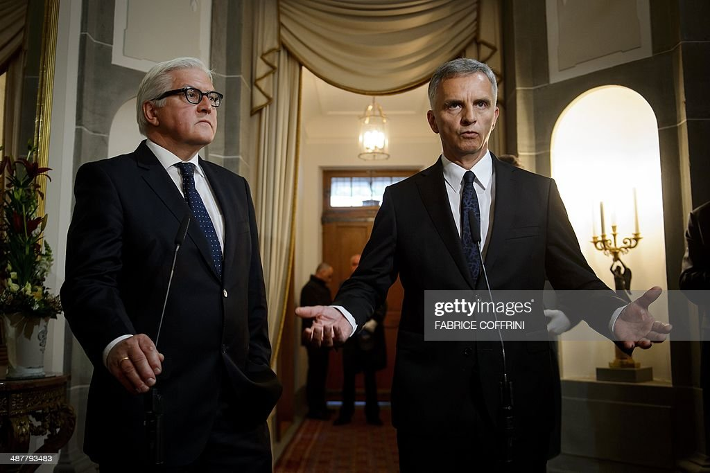 OSCE chairman and Swiss President <a gi-track='captionPersonalityLinkClicked' href=/galleries/search?phrase=Didier+Burkhalter&family=editorial&specificpeople=6269147 ng-click='$event.stopPropagation()'>Didier Burkhalter</a> (R) gestures next to German Foreign minister Frank-Walter Steinmeier during a press statement following their meeting on the OSCE inspectors held in Slavyansk by rebels on May 2, 2014 in Kehrsatz near the Swiss capital Bern.