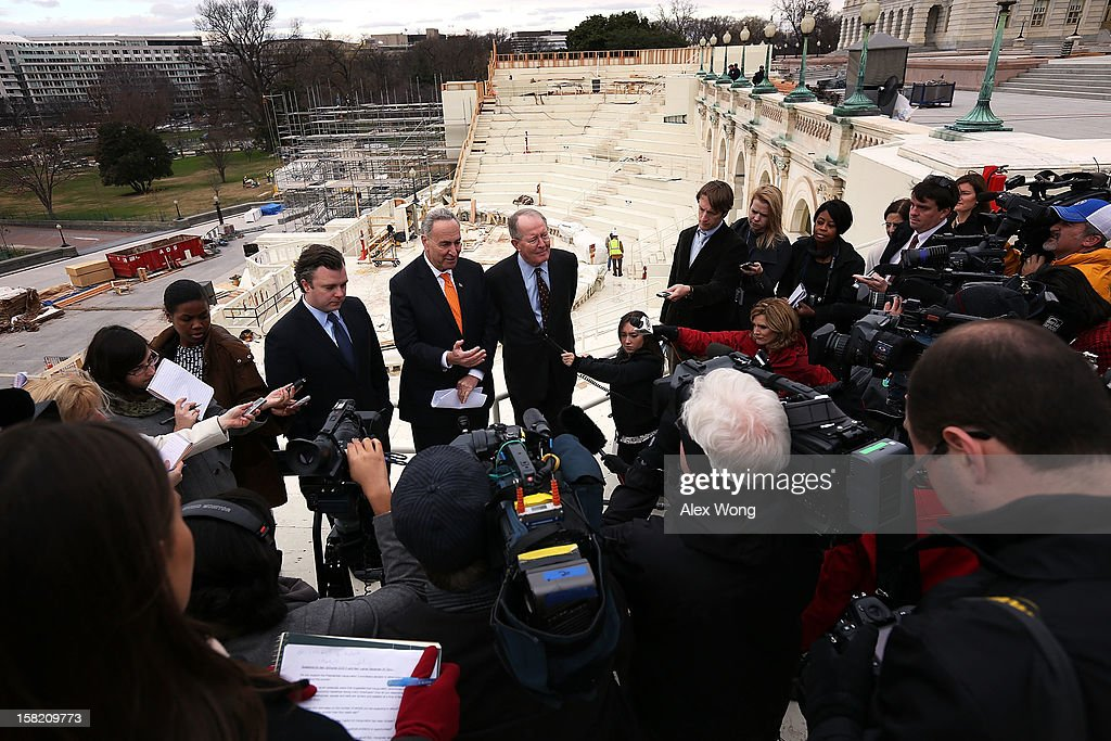 Chairman and Vice Chairman of the Joint Congressional Committee on Inaugural Ceremonies, U.S. Senators Charles Schumer (D-NY) (2nd L) and Lamar Alexander (R-TN) (R), and Presidential Inaugural Committee Chief Executive Officer Stephen Kerrigan (L) speak to members of the media during a tour of the Inaugural setup December 11, 2012 on Capitol Hill in Washington, DC. U.S. President Barack Obama will be sworn in for his second term as the President of the United States during a private ceremony on January 20 and a public ceremony on January 21, 2013.