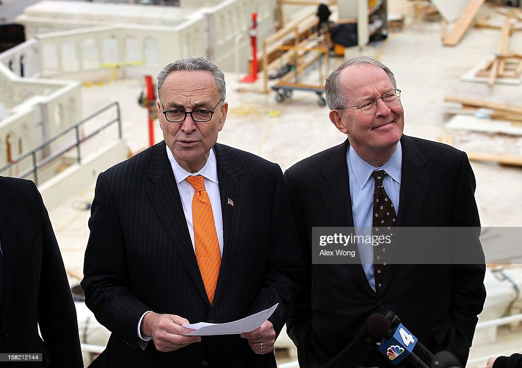 Chairman and Vice Chairman of the Joint Congressional Committee on Inaugural Ceremonies, U.S. Senators <a gi-track='captionPersonalityLinkClicked' href=/galleries/search?phrase=Charles+Schumer&family=editorial&specificpeople=171249 ng-click='$event.stopPropagation()'>Charles Schumer</a> (D-NY) (L) and <a gi-track='captionPersonalityLinkClicked' href=/galleries/search?phrase=Lamar+Alexander&family=editorial&specificpeople=211236 ng-click='$event.stopPropagation()'>Lamar Alexander</a> (R-TN) (R), speak to members of the media during a tour of the Inaugural setup December 11, 2012 on Capitol Hill in Washington, DC. President Barack Obama will be sworn in for his second term as the President of the United States during a private ceremony on January 20 and a public ceremony on January 21, 2013.