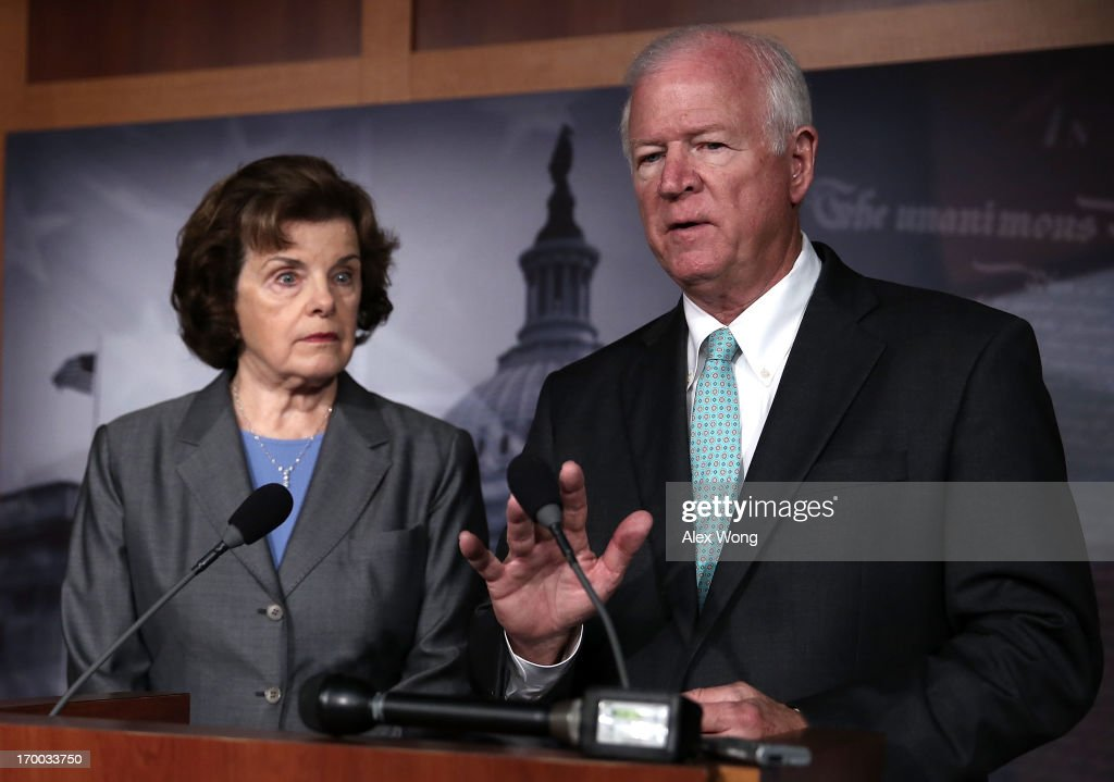 Chairman and Vice Chairman of the U.S. Senate Select Committee on Intelligence, Sen. Dianne Feinstein (D-CA) (L) and U.S. Sen. Saxby Chambliss (R-GA) (R), speak to members of the media about the National Security Agency (NSA) collevting phone records June 6, 2013 on Capitol Hill in Washington, DC. According to reports, the NSA has collected phone data, under a provision of the Patriot Act, of Verizon customers in teh U.S.