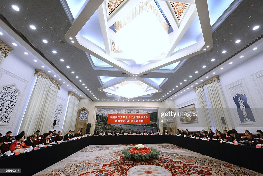 Chairman and Vice Secretary of the Party Committee of Xinjiang Uygur Autonomous Region, Nur Bekri (C) and other officials attend a panel discussion of Xinjiang delegation to the 18th National Congress of the Communist Party of China at the Great Hall of the People in Beijing on November 9,2012. Vice President Xi Jinping had moved closer to taking the reins of power and is expected to replace President Hu Jintao as party chief in a once-a-decade power transition, setting the stage for his promotion to president of the world's most populous nation, expected by March 2013.