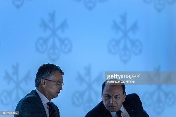 UBS chairman Axel Weber and UBS CEO Sergio Ermotti stand on stage before the start of the annual meeting of the Swiss banking giant in Zurich on May...