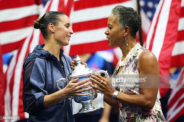 Chairman CEO and president Katrina Adams presents the winner's trophy to Flavia Pennetta of Italy after she defeated Roberta Vinci of Italy during...