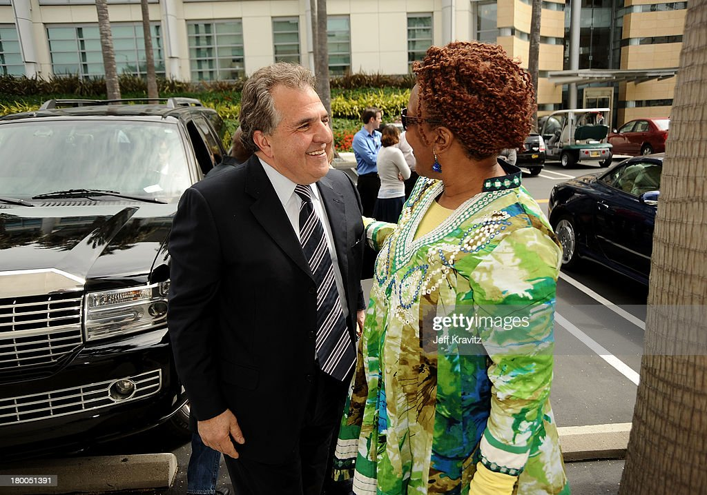 Chairman CEO Fox Film Entertainment Jim Gianopulos and actress CCH Pounder plant first tree in North America symbolizing the one million tree...