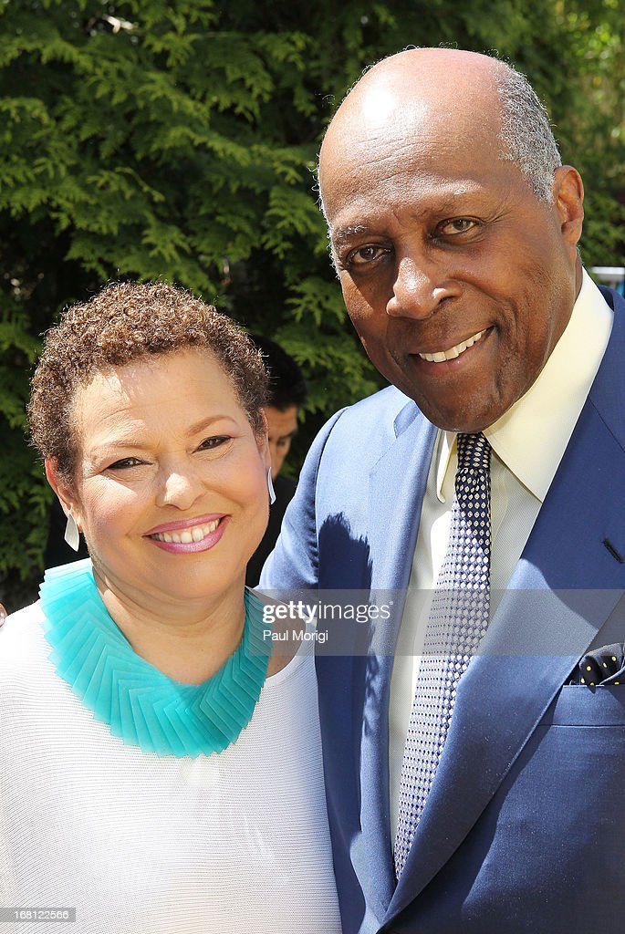 Chairman & CEO of BET Networks Debra Lee pose for a photo with <a gi-track='captionPersonalityLinkClicked' href=/galleries/search?phrase=Vernon+Jordan&family=editorial&specificpeople=240413 ng-click='$event.stopPropagation()'>Vernon Jordan</a> at the GRAMMY Foundation - Debra Lee house concert with Esperanza Spalding at Private Residence on May 5, 2013 in Washington, DC.