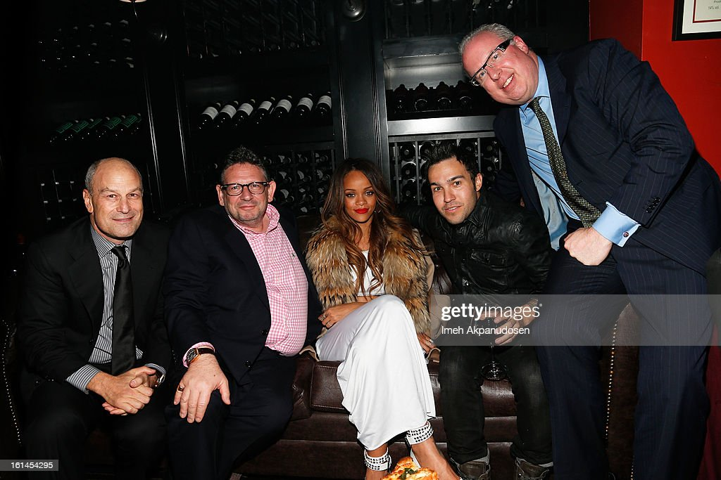 Chairman & CEO of Island Def Jam and Universal Motown Republic Group Barry Weiss, Universal Music Group CEO Lucian Grainge, recording artist Rihanna, musician Pete Wentz, and President/COO of Island Def Jam Music Group, Steve Bartels attend the Island Def Jam Grammy Party sponsored by Samsung and Pepsi at Osteria Mozza on February 10, 2013 in Los Angeles, California.