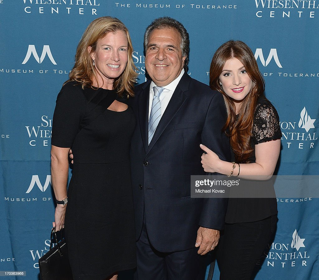 Chairman & Chief Executive Officer of Fox Filmed Entertainment Jim Gianopulos (C) arrives with his wife Ann (L) and daughter Mimi at the Simon Wiesenthal Center National Tribute Dinner at Regent Beverly Wilshire Hotel on June 11, 2013 in Beverly Hills, California.