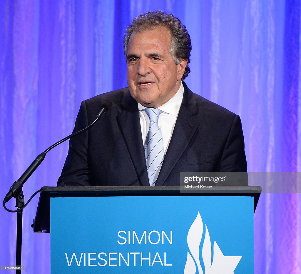 Chairman & Chief Executive Officer of Fox Filmed Entertainment Jim Gianopulos presents onstage after receiving the 2013 Simon Wiesenthal Center Humanitarian Award at the Simon Wiesenthal Center National Tribute Dinner at Regent Beverly Wilshire Hotel on June 11, 2013 in Beverly Hills, California.