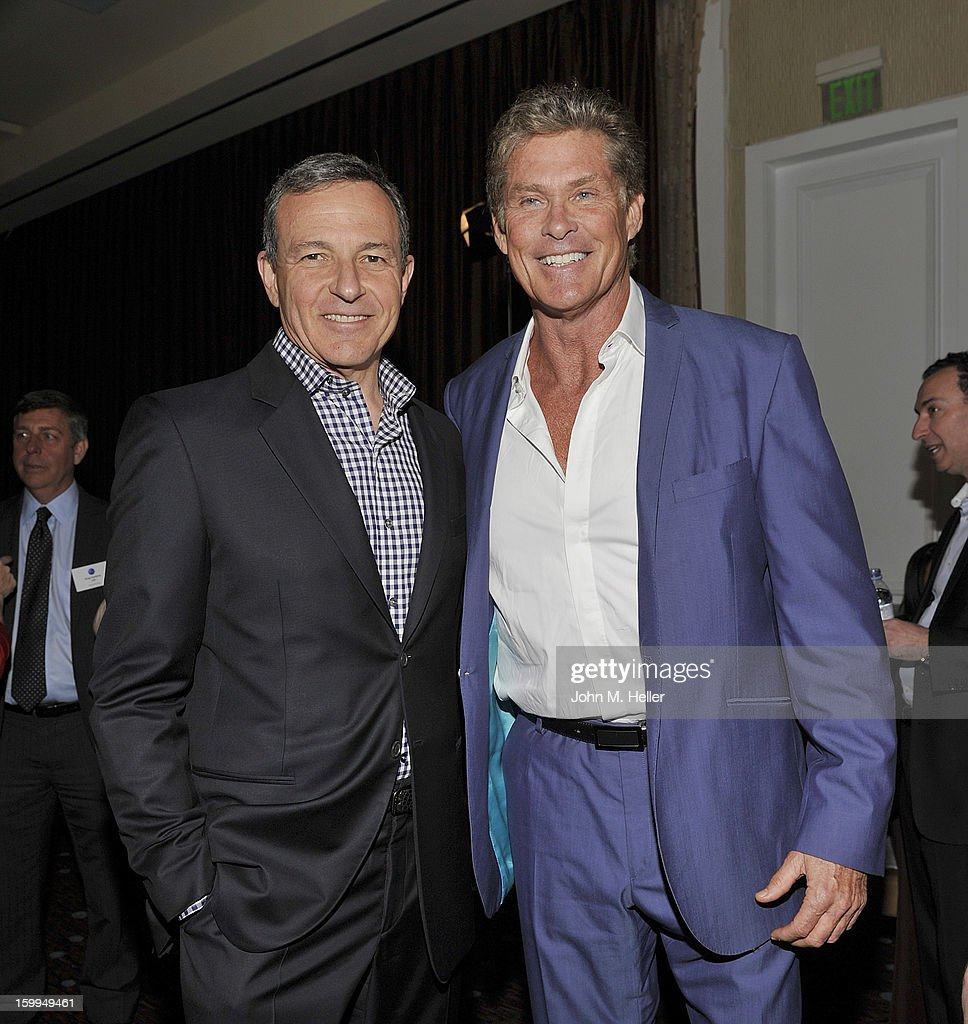 Chairman & Chief Executive Officer Of The Walt Disney Company Robert A. Iger and actor David Hasselhoff attend the Hollywood Radio & Television Society Newsmaker Luncheon Series at The Beverly Hilton Hotel on January 23, 2013 in Beverly Hills, California.