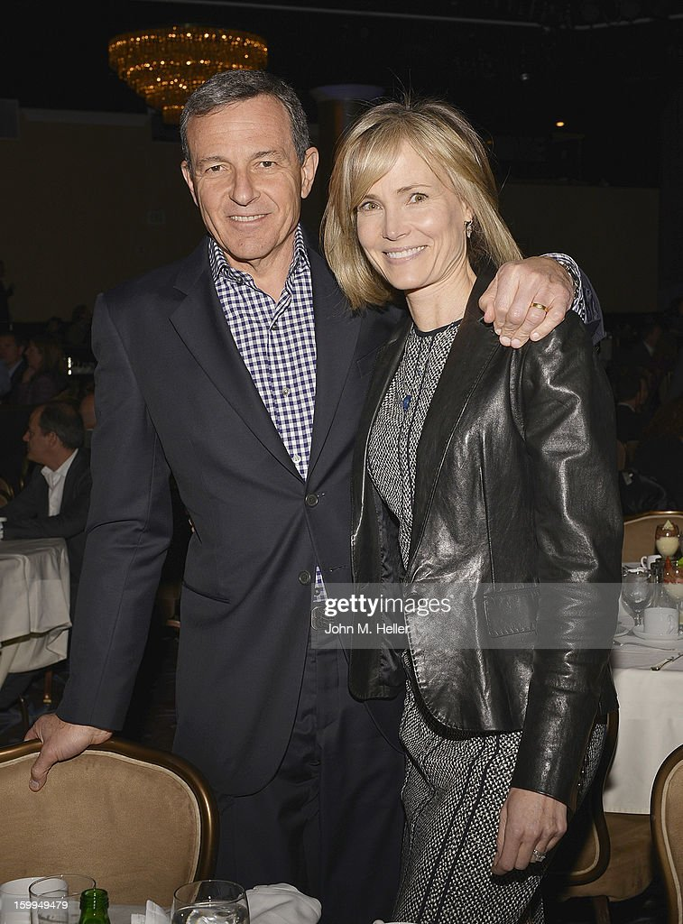 Chairman & Chief Executive Officer of the Walt Disney Company Robert A. Iger and American television correspondent, editor, author, former model and is currently a Senior Editor for the Huffington Post and a special correspondent for Bloomberg Television Willow Bay attend the Hollywood Radio & Television Society Newsmaker Luncheon Series at The Beverly Hilton Hotel on January 23, 2013 in Beverly Hills, California.