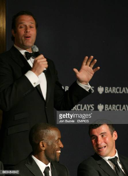 PFA Chairman Chris Powell jokes with Joe Calzaghe as Martin Bayfield speaks at the PFA Player of the Year Awards 2009 at the Grosvenor House Hotel...