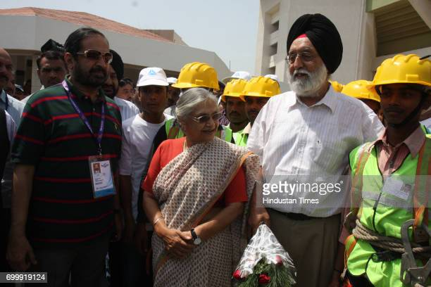 Chairman Commonwealth Games 2010 Suresh Kalmadi Delhi Chief Minister Sheila Dikshit and Minister for Sports and Youth Affairs MS Gill pose with...