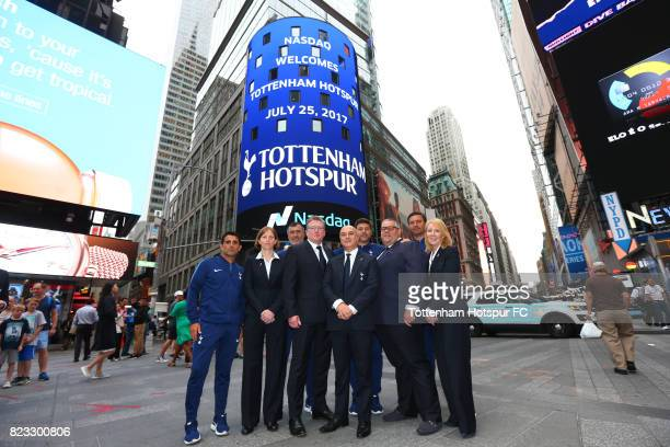 Chairman Daniel Levy and manager Mauricio Pochettino and staff pose as a Tottenham Hotspur advert plays on a screen in Time Square on July 25 2017 in...