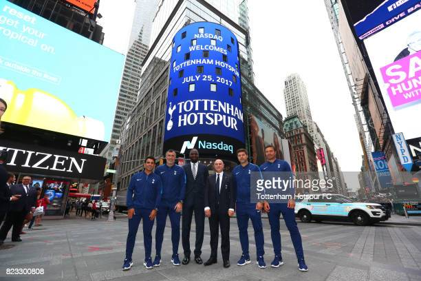 Chairman Daniel Levy and manager Mauricio Pochettino Ledley King and staff pose as a Tottenham Hotspur advert plays on a screen in Time Square on...