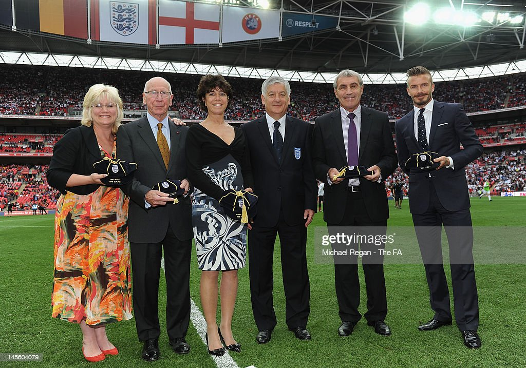FA Chairman David Bernstein (C) presented (L-R) Babette Wright, daughter of Billy Wright, who won 105 caps, Sir Bobby Charlton (106 caps), Stephanie Moore, the widow of the late Bobby Moore, who won 108 caps, Peter Shilton (125) and David Beckham (115) with their special Uefa '100th caps' award during the International Friendly match between England and Belgium at Wembley Stadium on June 2, 2012 in London, England.