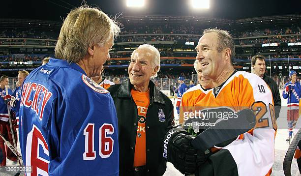 Chairman Ed Snider and Dave Poulin of the Philadelphia Flyers greets Pat Hickey of the New York Rangers after a 31 Flyers win during the Alumni Game...