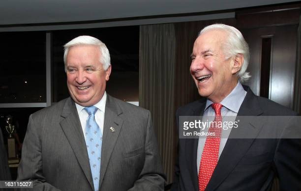 Chairman Ed Snider of the Philadelphia Flyers shares a laugh with Pennsylvania Gov Tom Corbett prior to a NHL against the Washington Capitals on...