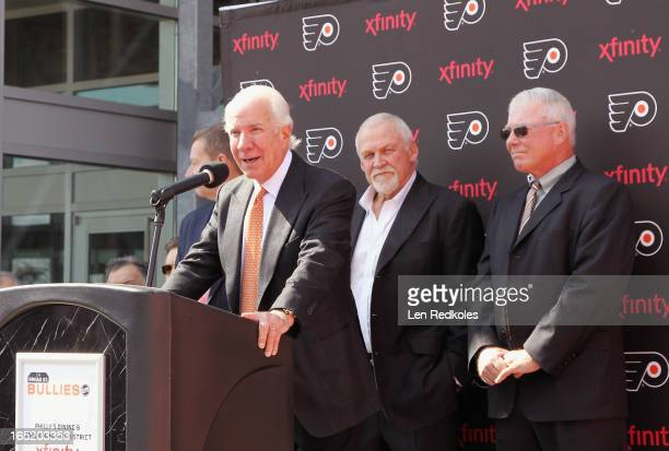 Chairman Ed Snider speaks with Philadelphia Flyers legends Bernie Parent and Bob Clarke about the unveiling of the statue named 'Walk Together...