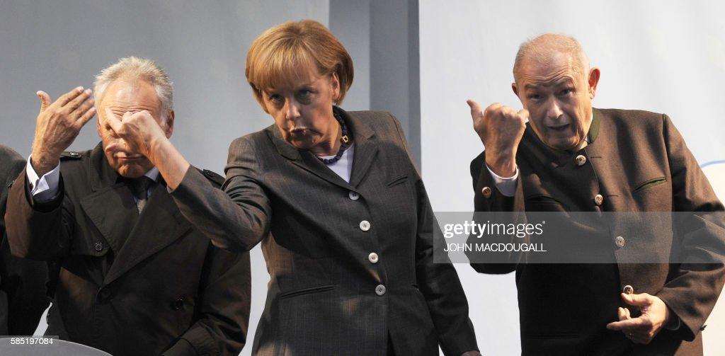 CSU Chairman Erwin Huber German Chancellor Angela Merkel and Bavarian Premier and CSU main candidate Guenther Beckstein gesture to LowerSaxony...