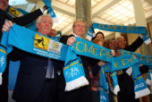 Chairman Frank Lowy and Australian Prime Minister Kevin Rudd pose with 'Come Play' scarves during the launch of Australia's bid to host the FIFA...