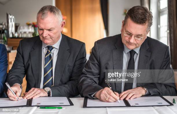 Chairman Greg Clarke and DFB president Reinhard Grindel sign a memorandum of understanding with the 'The FA' on March 22 2017 in Herdecke Germany