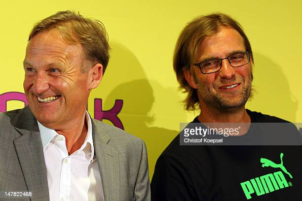 Chairman HansJoachim Watzke and head coach Juergen Klopp attend the press conference of Borussia Dortmund at Signal Iduna Park on July 4 2012 in...