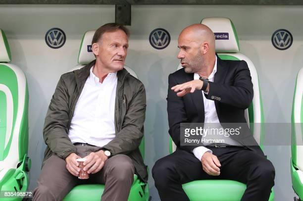 Chairman HansJoachim Watzke of Borussia Dortmund with Coach Peter Bosz of Borussia Dortmund during the Bundesliga match between VfL Wolfsburg and...