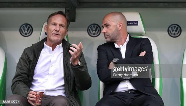 Chairman HansJoachim Watzke of Dortmund chats with head coach Peter Bosz of Dortmund prior to the Bundesliga match between VfL Wolfsburg and Borussia...