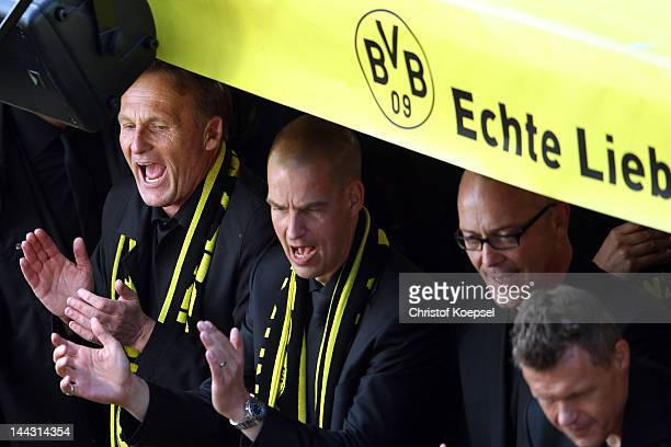 Chairman HansJoachim Watzke of Dortmund sings during a parade at Borsigplatz celebrating Borussia Dortmund's Bundesliga and DFB Cup win on May 13...