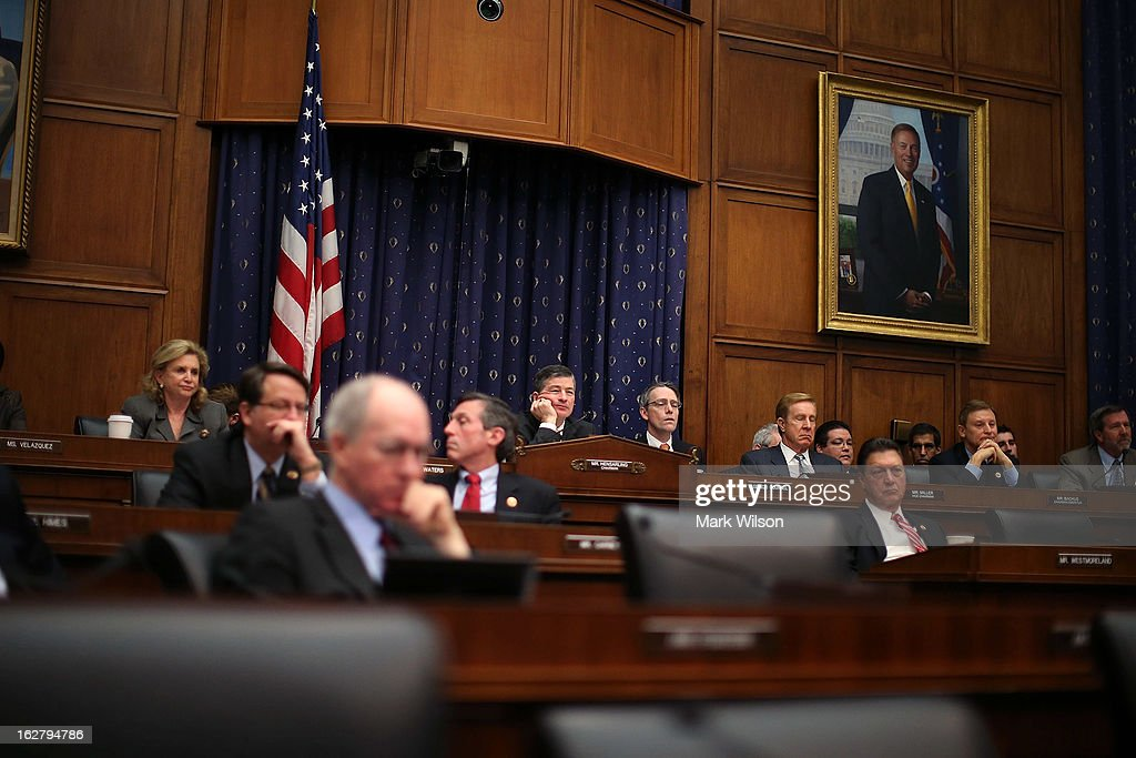 Chairman Jeb Hensarling (R-TX)(C) is flanked by committee members as they listen to Federal Reserve Board Chairman Ben Bernanke testify during a House Financial Services Committee hearing on Capitol Hill, February 27, 2013 in Washington, DC. The committee is hearing testimony from Chairman Bernanke on the state if the U.S. economy and monetary policy.