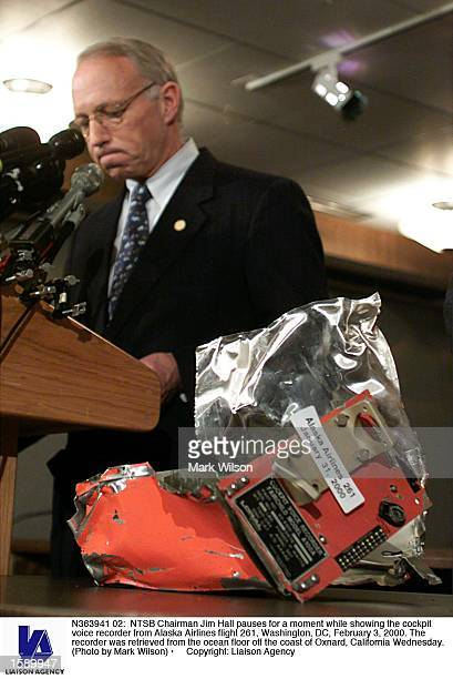 Chairman Jim Hall pauses for a moment while showing the cockpit voice recorder from Alaska Airlines flight 261 Washington DC February 3 2000 The...