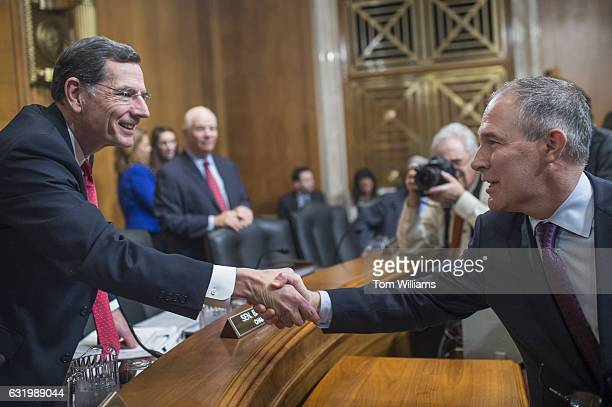 Chairman John Barrasso RWyo left greets Scott Pruitt Presidentelect Trump's nominee to be administrator of the Environmental Protection Agency before...