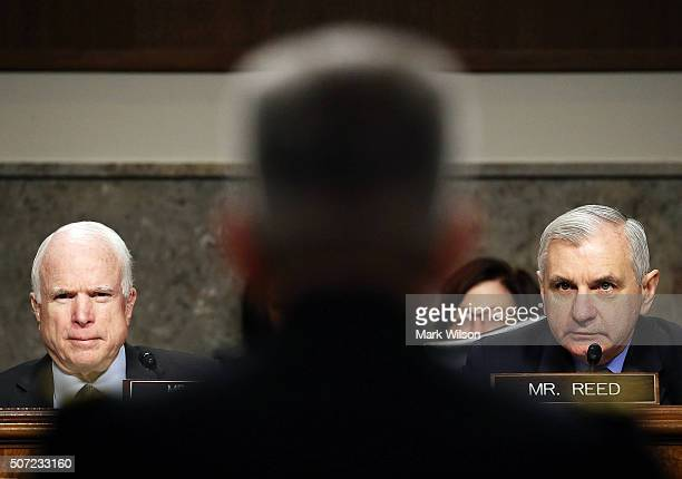 Chairman John McCain and Sen Jack Reed listen to Lt General John W Nicholson Jr speak during his confirmation hearing before the Senate Armed...