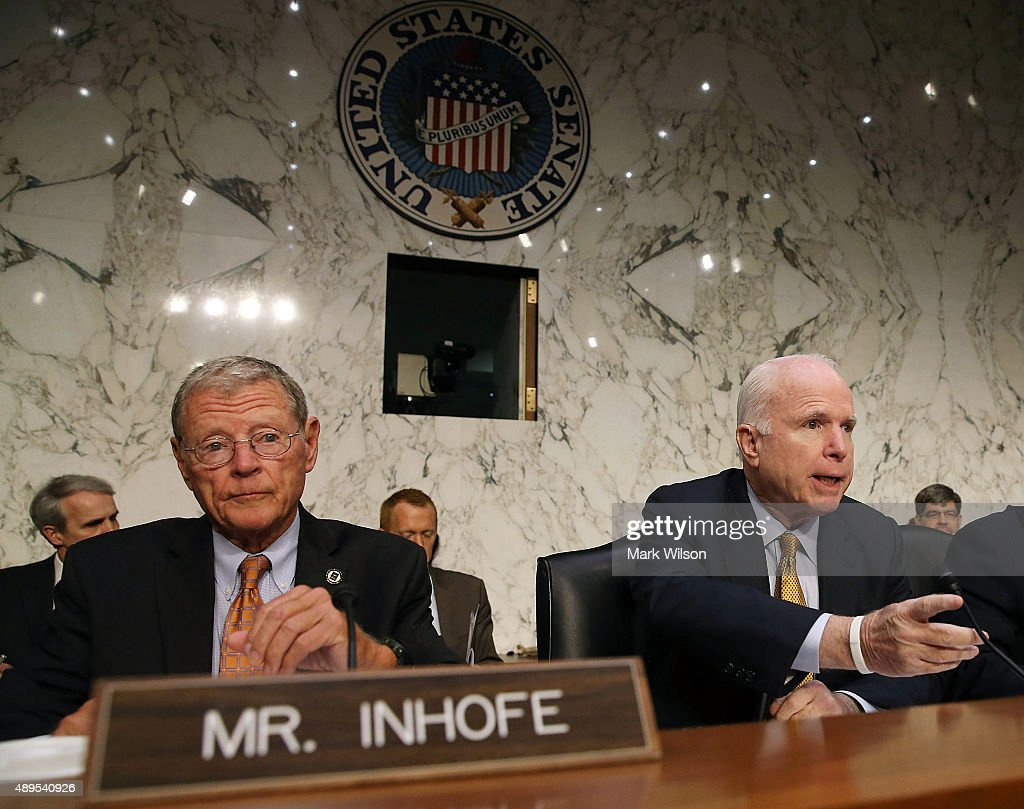 Chairman <a gi-track='captionPersonalityLinkClicked' href=/galleries/search?phrase=John+McCain&family=editorial&specificpeople=125177 ng-click='$event.stopPropagation()'>John McCain</a> (R-AZ) (R) questions Retired US Army Gen. David Petraeus while Sen. James Inhofe (R-OK) (L) listens, during a Senate Armed Services Committee hearing on Capitol Hill September 22, 2015 in Washington, DC. The hearing focused on United States Middle East Policy.