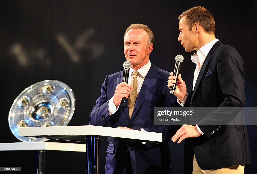 Chairman Karl-Heinz Rummenigge (L) of Bayern Muenchen talks to presenter Kai Pflaume during the Official Champion dinner after winning the German championship at Postpalast on May 12, 2013 in Munich, Germany.