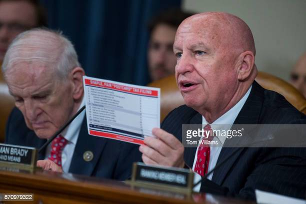 Chairman Kevin Brady RTexas holds a tax filing postcard during a House Ways and Means Committee markup of the Republican's tax reform plan titled the...