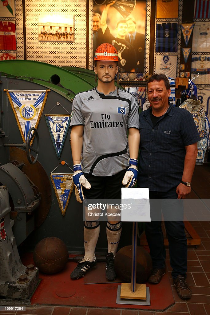 Chairman Klaus Hermanatus of Schachtschatz Museum (R) poses with a puppet of former player Frank Rost of Scchalke at Schachtschatz Museum coal-mine Hugo tray two on June 4, 2013 in Gelsenkirchen, Germany.