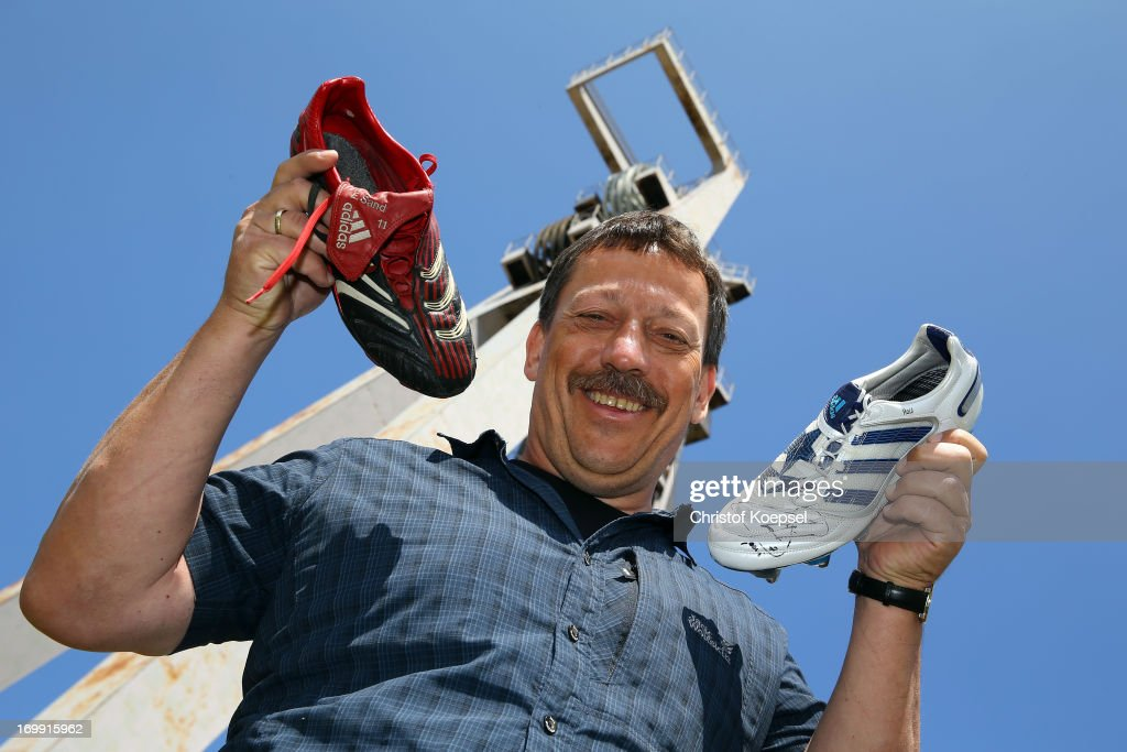 Chairman Klaus Hermanatus of Schachtschatz Museum poses with football shoes of former player Ebbe Sand (L) and Raul (R) of schalke at Schachtschatz Museum coal-mine Hugo tray two on June 4, 2013 in Gelsenkirchen, Germany.