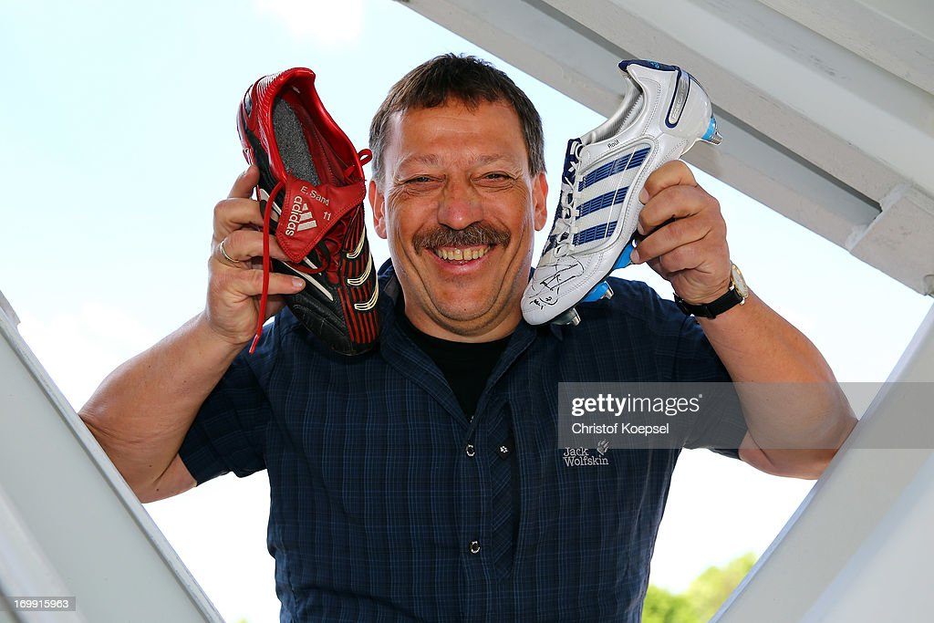 Chairman Klaus Hermanatus of Zeche Hugo poses with football shoes of former player Ebbe Sand (L) and Raul (R) of schalke at Schachtschatz Museum coal-mine Hugo tray two on June 4, 2013 in Gelsenkirchen, Germany.