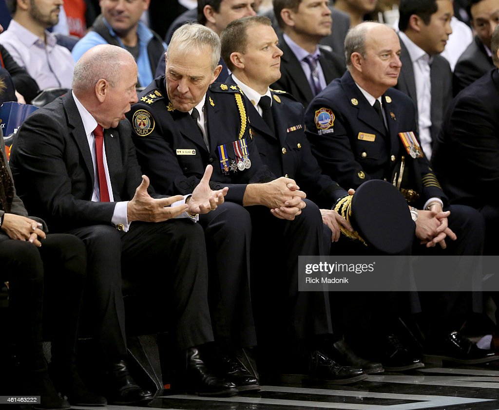 Chairman Larry Tannenbaum (left) talks with TPS Chief Bill Blair at a game which honoured First Responders. Toronto Raptors vs Detroit Pistons during 1st half action at the Air Canada Centre of the NBA season on January 12, 2015.