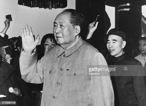 Chairman Mao TseTung in failing health waving to the crowds followed by Lin Biao 1976 Printed following his death on September 9th 1976