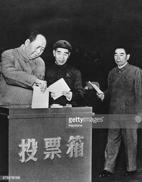 Chairman Mao TseTung of China posting his vote in a ballot box followed by Lin Biao and Zhou Enlai circa 1950