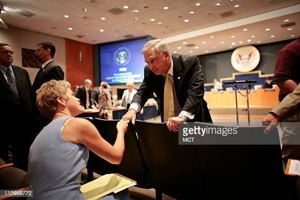 Chairman Mark Rosenker greets Amy Clay the wife of pilot Jeff Clay during a break in an NTSB meeting on the Lexington Kentucky crash investigation on...