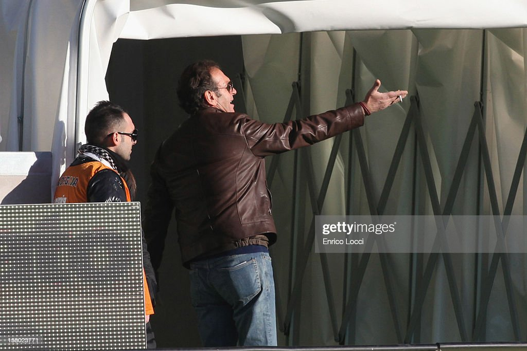 Chairman Massimo Cellino (L) of Cagliari gestures from the sidelines during the Serie A match between Cagliari Calcio and AC Chievo Verona at Stadio Sant'Elia on December 9, 2012 in Cagliari, Italy.